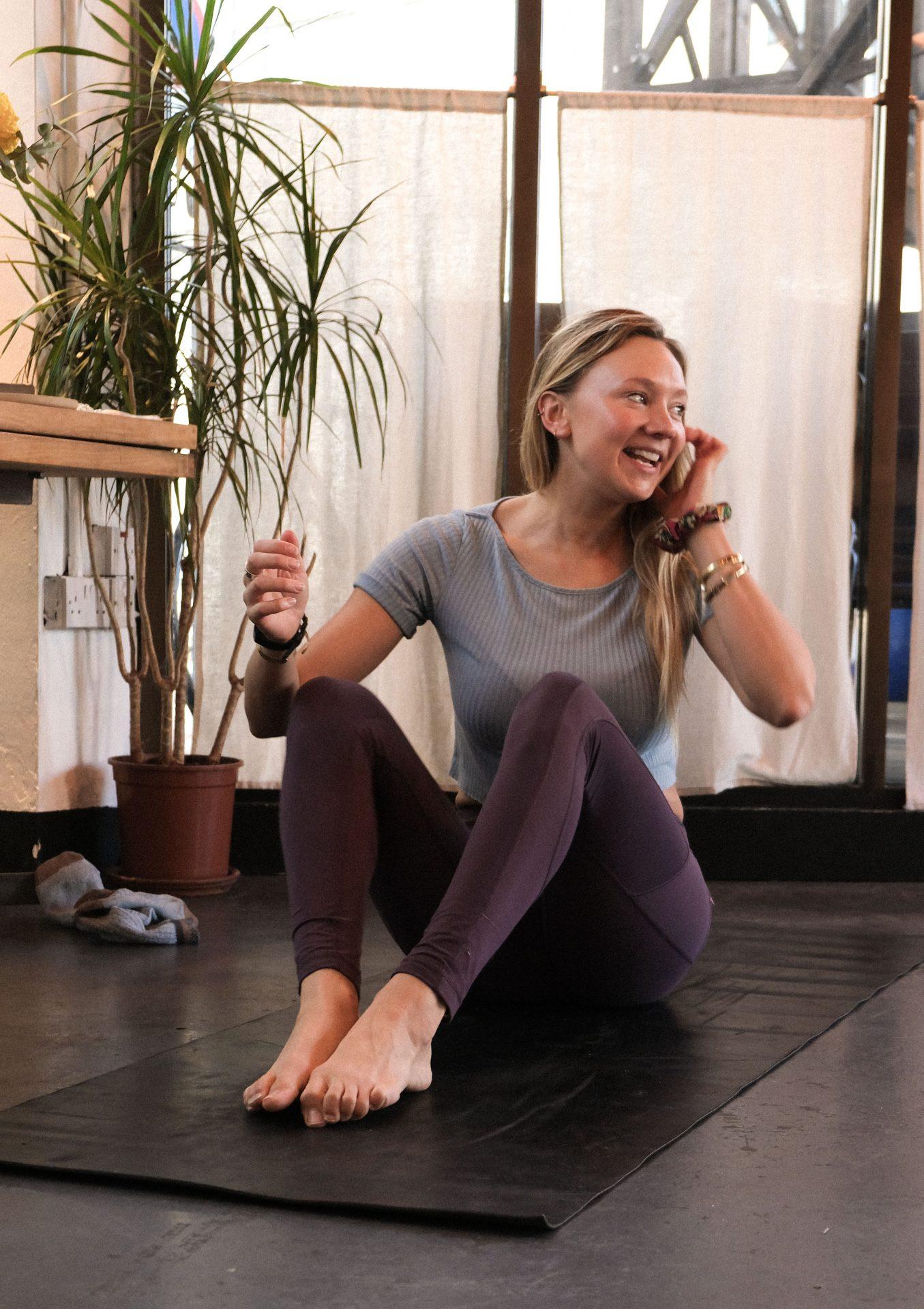 Jenny Clark yoga teacher, teaching a yoga class at a yoga brunch club